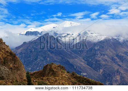snow-capped mountains on a sunny day