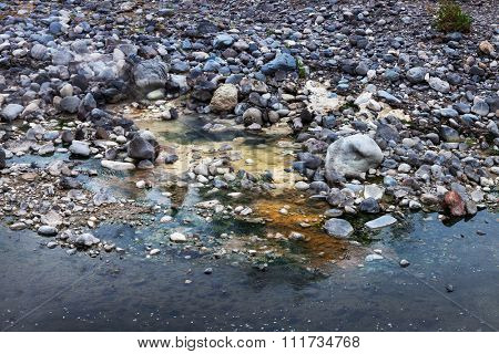 outdoor hot spring in the mountain river