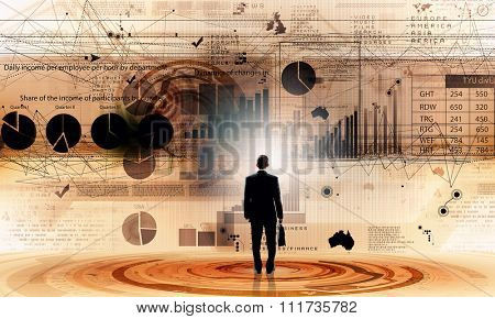 Rear view of businessman with suitcase and infographs on virtual panel