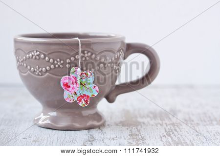 a cup with flower shape teabag
