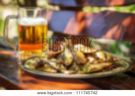 Tasty Smoked Herring Lies On A Plate With Glass Of Cold Beer