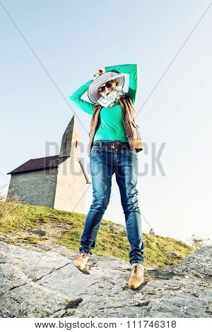 Young Joyful Woman With Stylish Hat And An Old Romanesque Church Archangel Michael, Slovakia