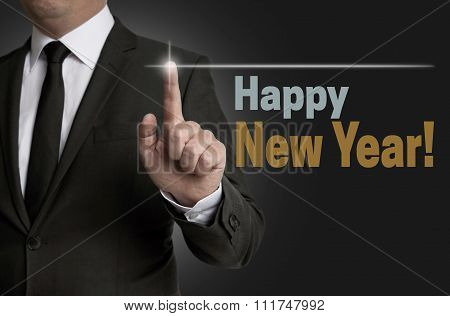 Happy New Year Touchscreen Operated By Businessman Concept