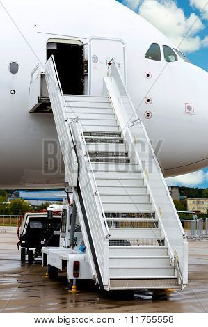 Large passenger jet  with ladder