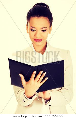 African businesswoman with a notebook.