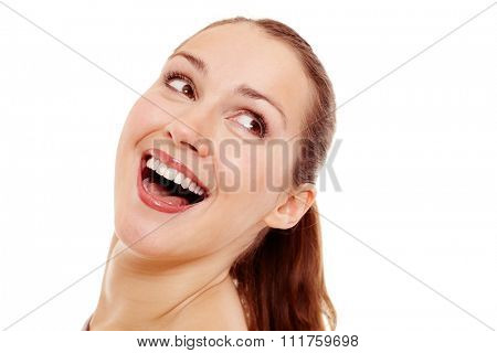 Young beautiful woman with ponytail hairstyle and perfect white teeth looking aside and loudly laughing isolated on white background - fun concept