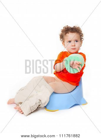 Baby  On Potty With Lavatory Paper
