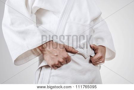 Tying Kimono Belt Close Up Image