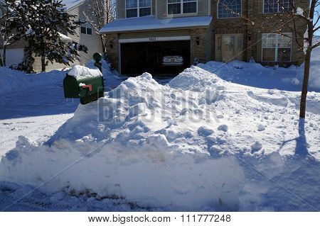 Mailbox in a Snowbank