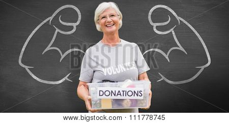 Happy grandmother holding donation box against black background