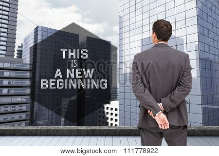 Motivational new years message against businessman standing with hands behind back