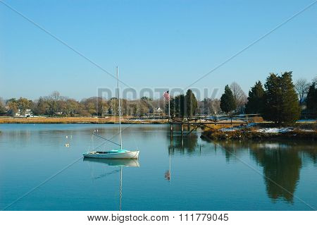 A sailboat moored in a calm bay