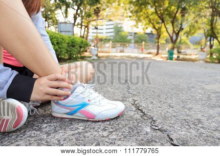 Sports Injury. Woman Pain In Ankle While Jogging