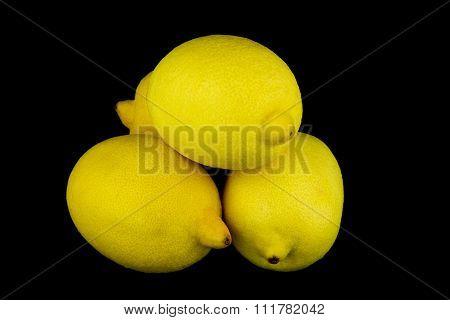 Whole Lemons On Black Background