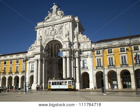 LISBON-PORTUGAL NOVEMBER 06, 2015:  View of the arch with a yellow tramway at The Praca do Comercio or Commerce Square and located in the city of Lisbon, Portugal.