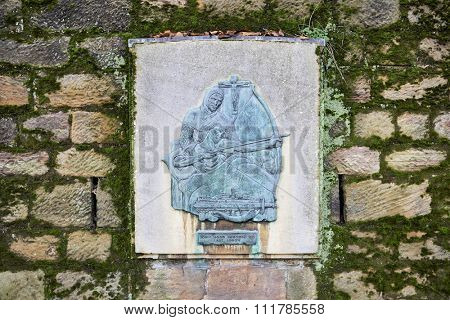 NOTTINGHAM, UK - DECEMBER 04: Bronze plaque outside Nottingham castle depicting Robin Hood shooting his last arrow. December 04, 2015 in Nottingham.