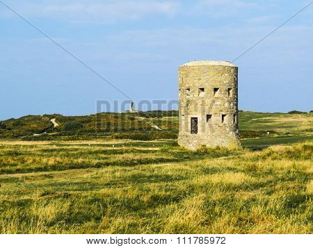 Ancient watchtower on the Guernsey island. Bailiwick of Guernsey