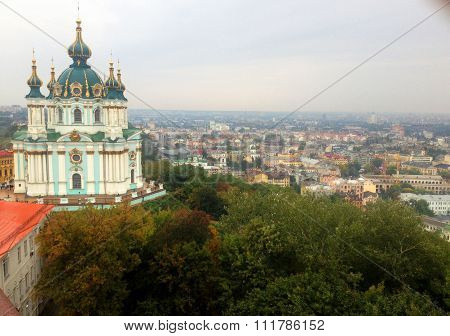 View to Podil and The St. Andrew's Church - oldest part of Kyiv , the capital of Ukraine