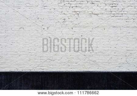 White brick wall and black skirting texture