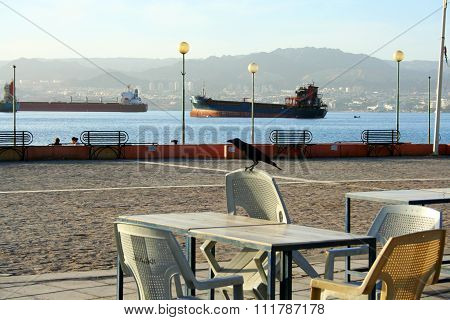 Aqaba, Jordan - December 11, 2012: Urban beach in jordanian town Aqaba. Red Sea