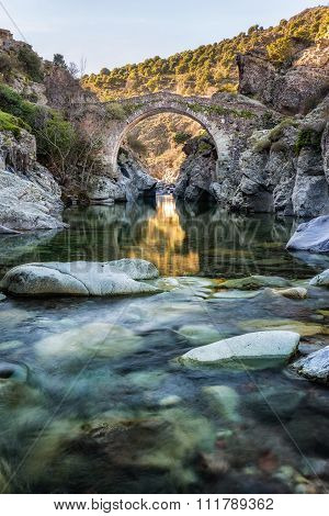 River Passing Through Genoese Bridge At Asco In Corsica