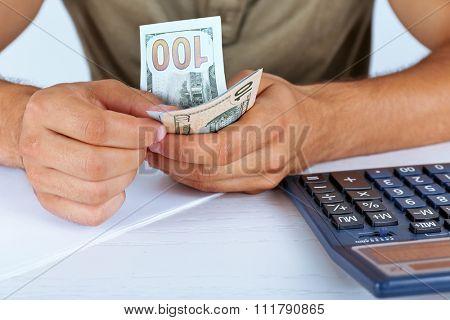 Calculating money, close up