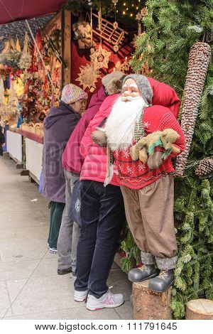 Santa, Teddy Bear, and The Market