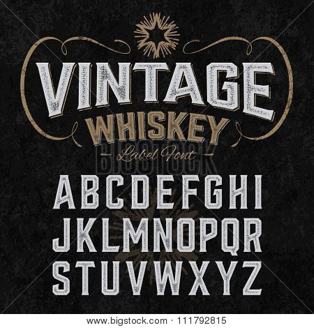 Vintage whiskey label font with sample design. Ideal for any design in vintage style. Vector.