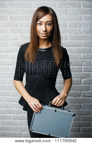 Beautiful Girl In The Studio Holding An Aluminum Case