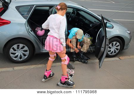 Brother and sister getting ready for inline skating