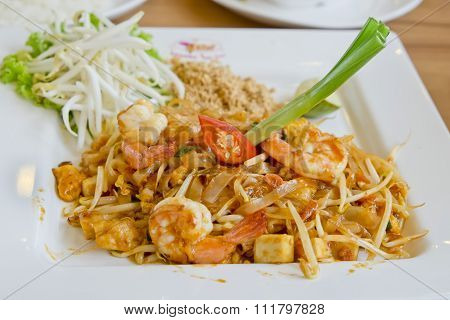 Delicious Rice Noodles With Shrimp Close-up On A Plate. Thai Dish, In Thai Language We Call Pad-thai