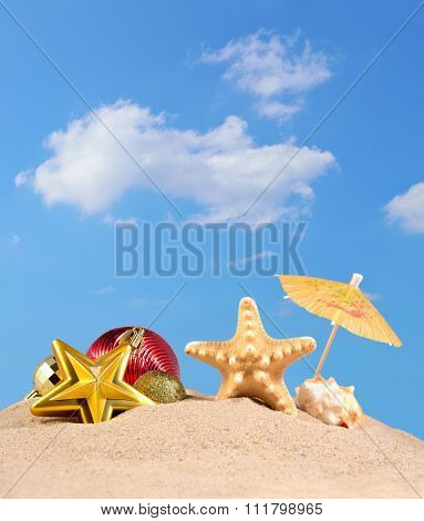 Christmas Decorations, Seashells And Starfish On A Beach Sand