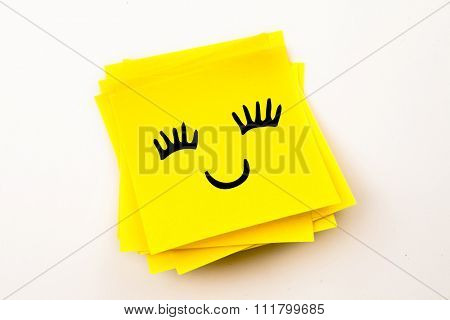 Smiling face against sticky note