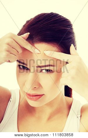 Close up on woman checking her wrinkles.