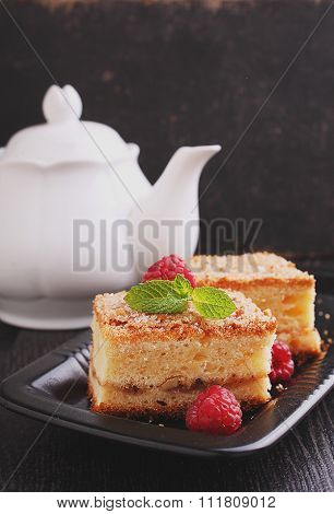 homemade cake with walnuts, cinnamon and sugar on a dark background