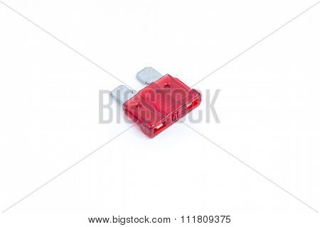 Car Fuse. Red Electrical Automotive Fuse Or Circuit Breaker Isolated On White Background