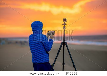 Photographer filming time lapse video