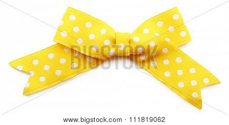 Yellow dotted bow isolated on white background