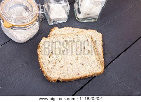 Gluten Free Bread With Spelled Flower On Black Wooden Background