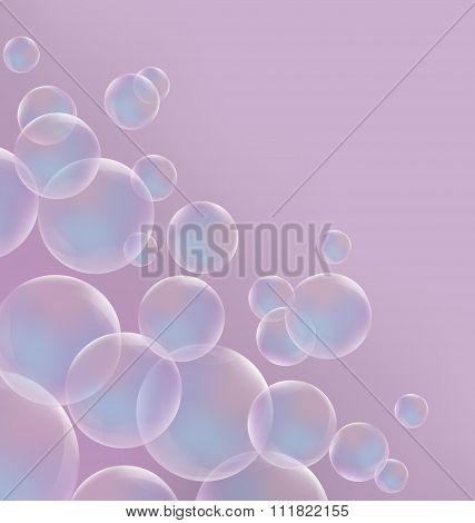 Transparent blue soap bubbles on pink