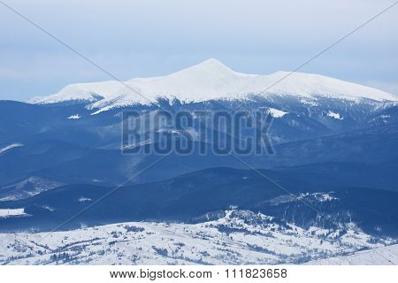 Winter landscape a cloudy day. Mountain peak in snow. View of Mount Hoverla, Carpathian Mountains, Ukraine