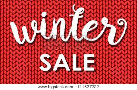 Winter sale. Ink painted inscription on red background from knitted wool. Vector illustration.