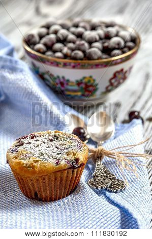 one muffin and a Cup of blackcurrant, front view