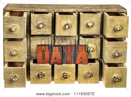 data storage concept - data word in vintage letterpress wood type stained by red ink and primitive rustic wooden apothecary or catalog drawer cabinet
