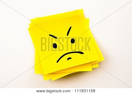 Angry face against sticky note