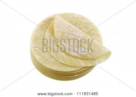 Closeup of fresh dumpling wrappers to make wontons and other Chinese food, isolated on white background