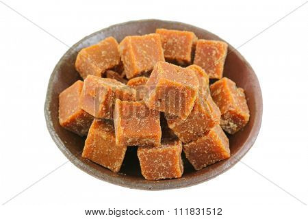 A bowl full of blocks of dark brown sugar made of cane sugar (jaggery), by evaporation of the sap of sugar cane juice