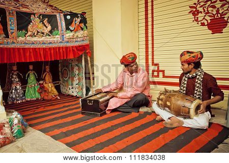 Indian Musicians Playing Traditional Songs On Puppetry Performance With Toys
