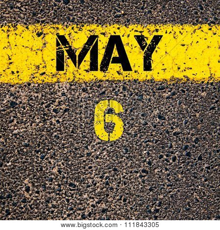6 May Calendar Day Over Road Marking Yellow Paint Line