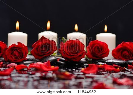 Red rose ,petals with four candle and therapy stones